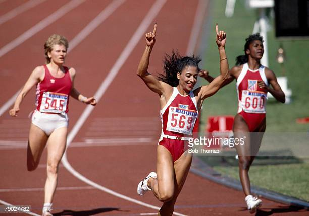 American track athlete Florence GriffithJoyner celebrates after finishing first to win the gold medal in the final of the Women's 100 metres event at...