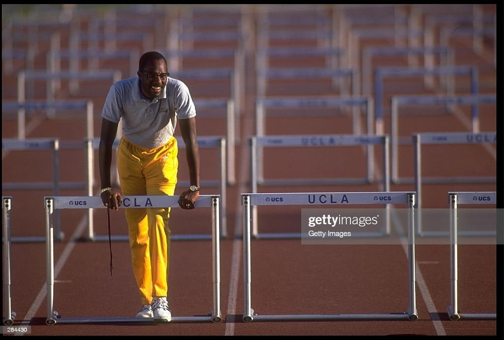 American track coach Bobby Kersee leans on a hurdle at Drake Stadium on the campus of UCLA in Westwood California January 27 1995