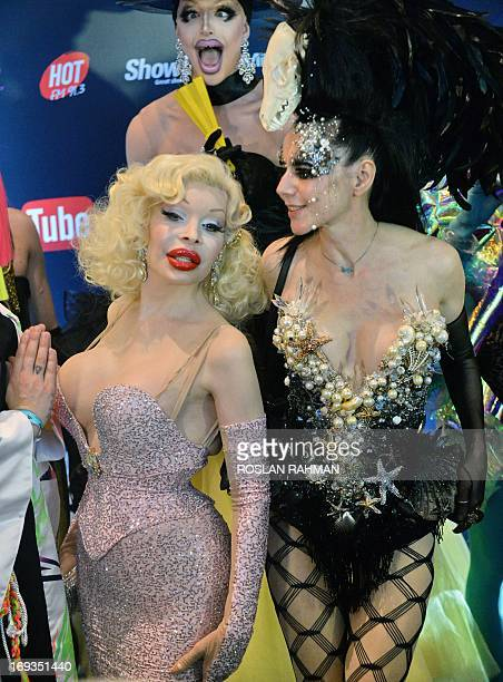 American transgender model Amanda Lepore arrives with her colourful entourage to attend the Singapore Social Star Awards at the Marina Bay Sands in...