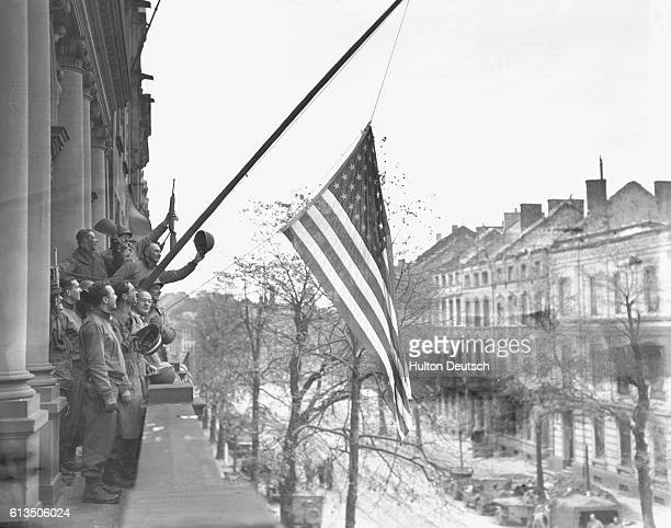 American troops fly the stars and stripes over Aachen 1945