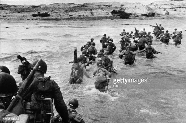 American troops landed on Normandy beaches to come as reinforcements during the historic DDay 06 June 1944 during WW2 American troops supporting...