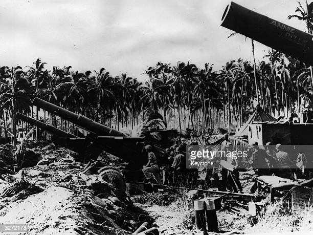 American troops load the heavy artillery on Leyte Island taking aim at Japanese positions