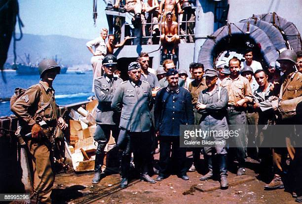 American troops with German prisoners of war on board a Liberty ship in the English Channel during the Allied invasion of Normandy June 1944