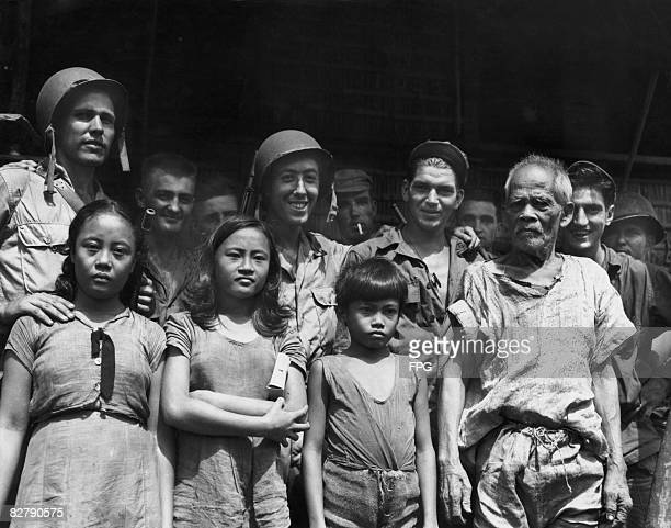 American troops with Philippine civilians after the Battle of Leyte in the Philippines 20th October 1944 Among the group are US Coast Guardsmen Carol...