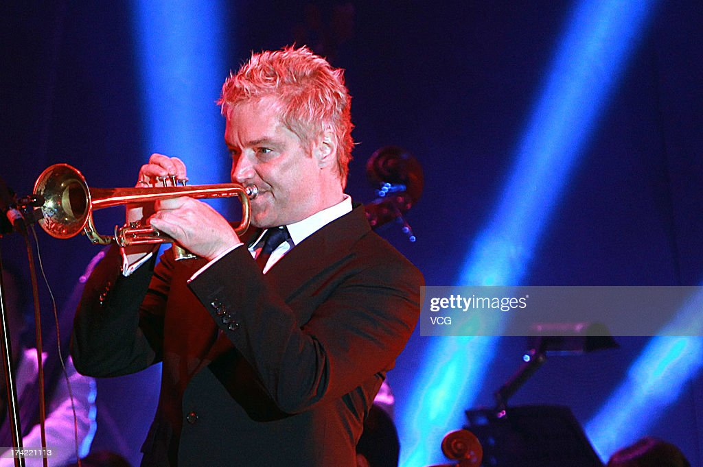 American trumpeter and composer <a gi-track='captionPersonalityLinkClicked' href=/galleries/search?phrase=Chris+Botti&family=editorial&specificpeople=223897 ng-click='$event.stopPropagation()'>Chris Botti</a> performs on stage during the clothing ceremony of Music in the Summer Air on July 21, 2013 in Shanghai, China.