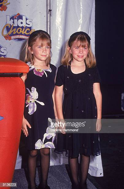 American twin child actors MaryKate and Ashley Olsen smile at the Nickelodeon Kid's Choice Awards May 11 1996
