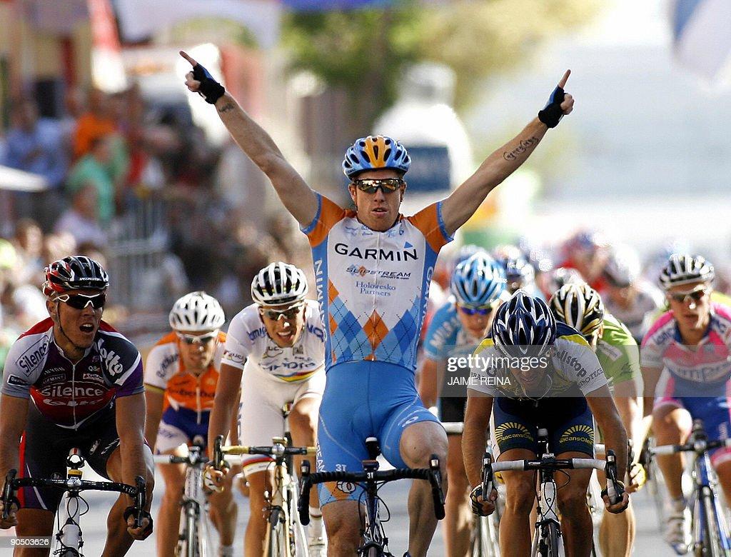 American Tyler Farrar of the Garmin team (C) celebrates as he crosses the finish line of 11th stage of the Vuelta Tour of Spain, a 200-kilometre ride from Murcia to Caravaca de la Cruz, on September 9, 2009 in Caravaca de la Cruz. AFP PHOTO / Jaime REINA