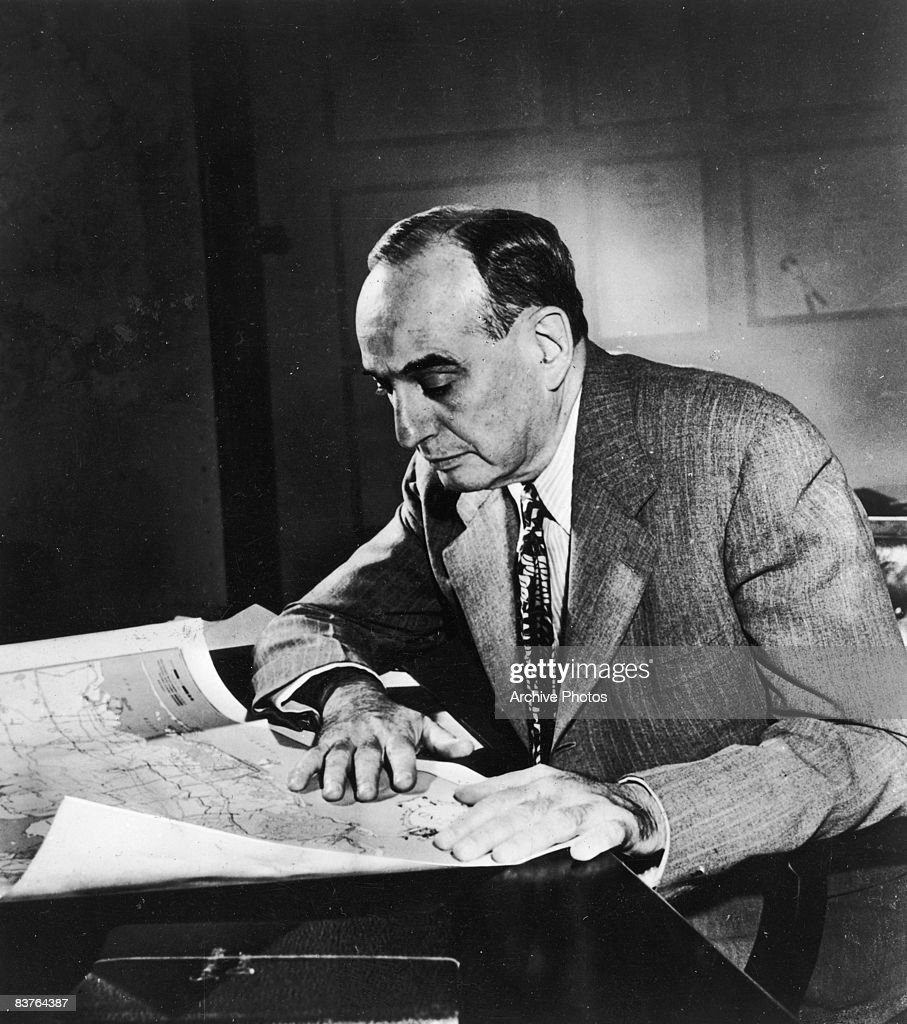 American urban planner and New York City Parks Department Commissioner Robert Moses Robert Moses works with a map at his desk 1958