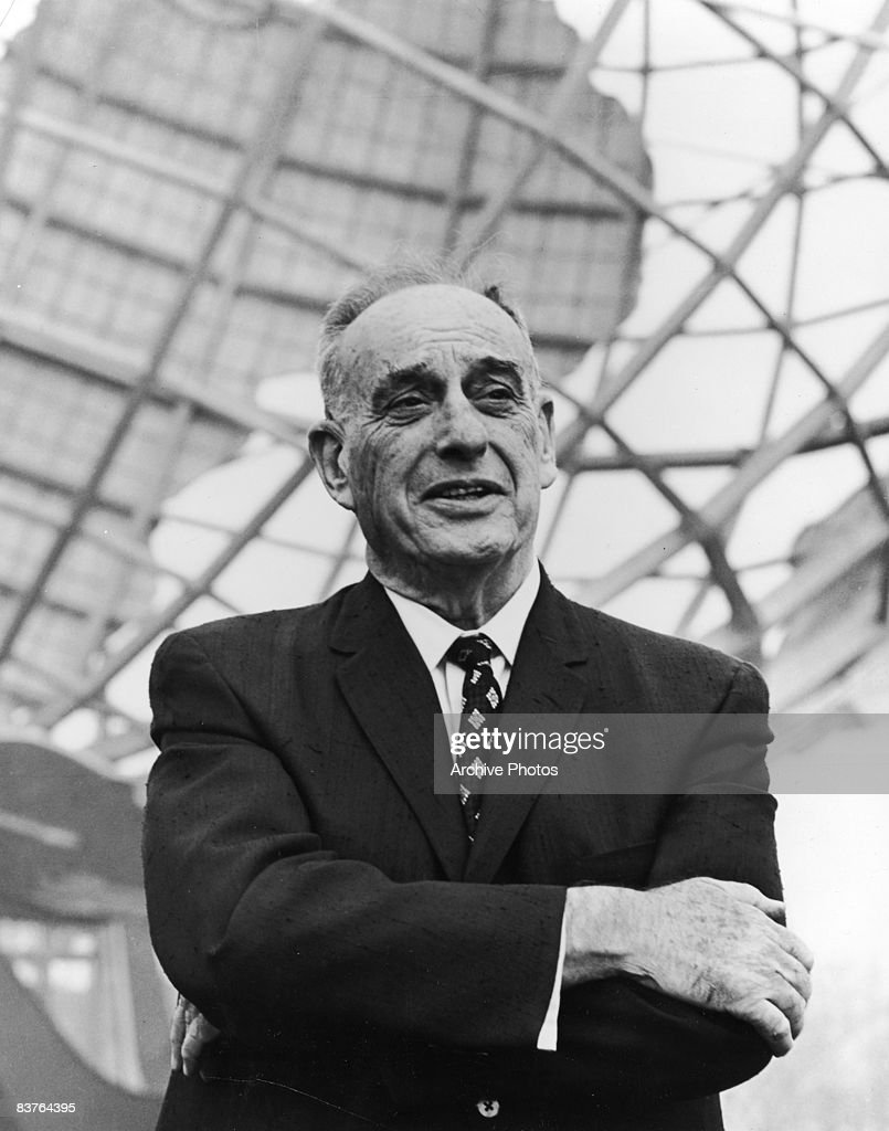 American urban planner Robert Moses president of the World's Fair stands in front of the Unisphere monument at the World's Fair site in Flushing...