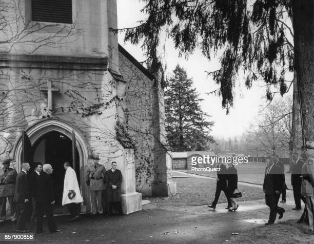 American US President John F Kennedy and First Lady Jacqueline Kennedy walk arminarm as they arrive at St James Episcopal Church for former First...