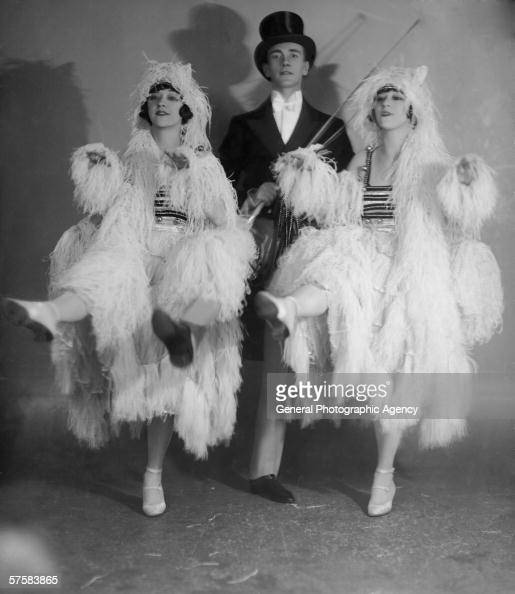 American vaudeville performers Rosy and Jenny Dolly known professionally as The Dolly Sisters simulate a carriage team of white horses in their act...