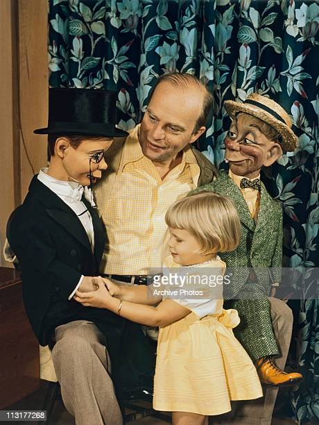 American ventriloquist Edgar Bergen with two dummies including Charlie McCarthy wearing a tuxedo and his young daughter Candice Bergen circa 1950