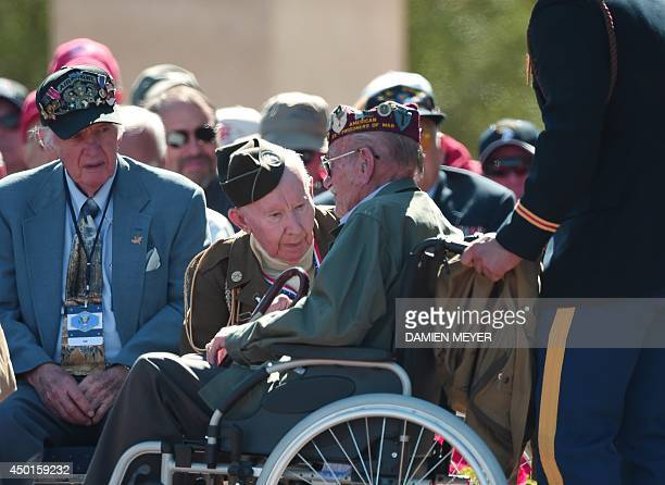 American veterans speak during a joint FrenchUS DDay commemoration ceremony at the Normandy American Cemetery and Memorial in Collevillesurmer...