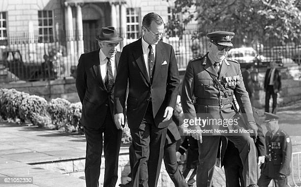 American Vice President George H W Bush laying a wreath with the Minister of Defence Patrick Cooney and the Army Chief of Staff Lt Gen Louis Hogan at...