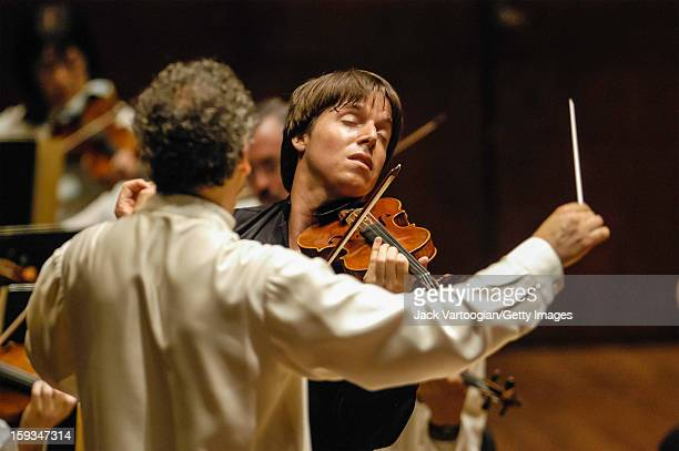 American violinist Joshua Bell performs with French conductor Louis Langree and the Mostly Mozart Festival Orchestra during a performance of Mozart's...