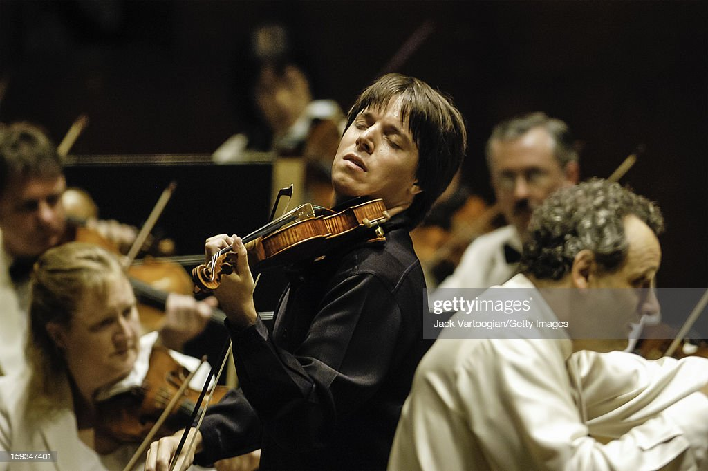 American violinist <a gi-track='captionPersonalityLinkClicked' href=/galleries/search?phrase=Joshua+Bell+-+Musician&family=editorial&specificpeople=556072 ng-click='$event.stopPropagation()'>Joshua Bell</a> performs with French conductor Louis Langree (right) and the Mostly Mozart Festival Orchestra during a performance of Mozart's 'Concerto for Violin and Orchestra in A major, No. 5, K. 219' (subtitled the 'Turkish' concerto, 1775) at Avery Fisher Hall at Lincoln Center, New York, New York, August 21, 2004.