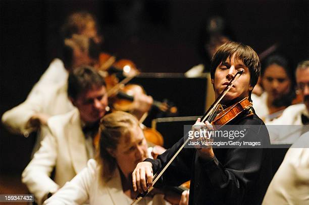American violinist Joshua Bell performs with the Mostly Mozart Festival Orchestra during a performance of Mozart's 'Concerto for Violin and Orchestra...