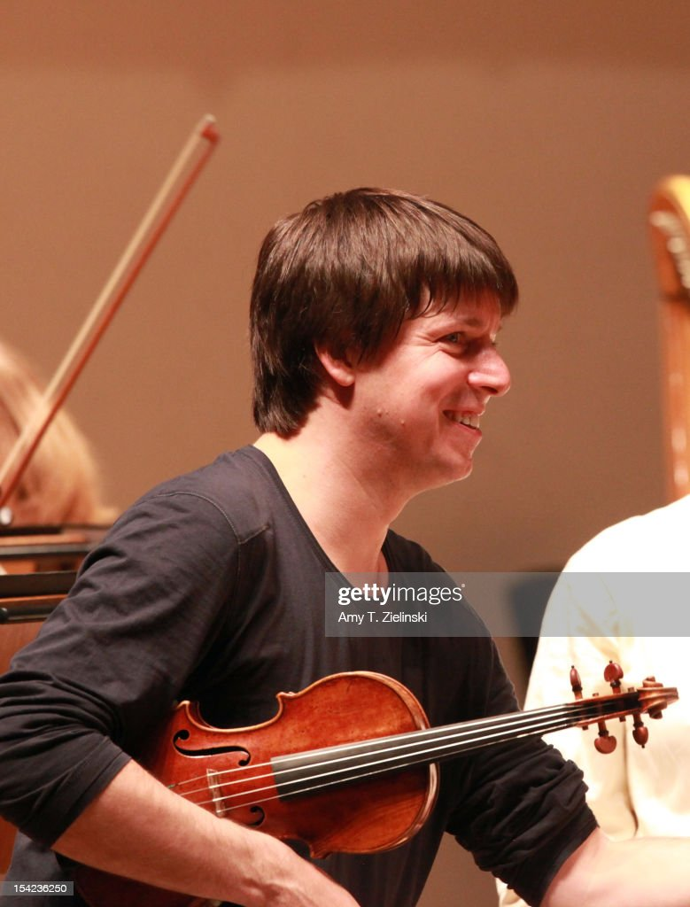 American violinist, music director, <a gi-track='captionPersonalityLinkClicked' href=/galleries/search?phrase=Joshua+Bell+-+Musician&family=editorial&specificpeople=556072 ng-click='$event.stopPropagation()'>Joshua Bell</a> performs Scottish Fantasy op.46 by Bruch and Symphony No.1 in C by Beethoven during rehearsal before a performance with the Academy of St Martin in the Fields at Cadogan Hall on October 16, 2012 in London, United Kingdom.