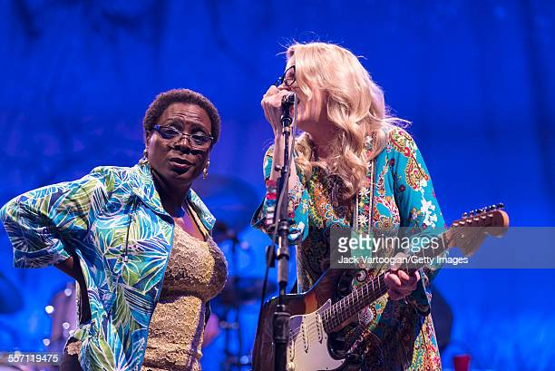 American vocalist Sharon Jones performs as a special guest with musician Susan Tedeschi on guitar and the Tedeschi Trucks Band on opening night of...
