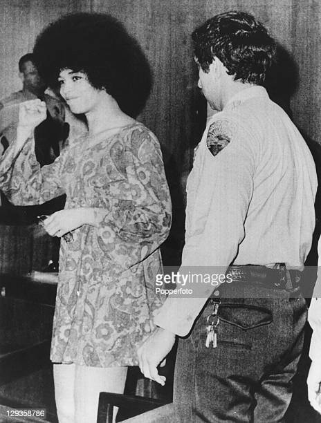 American writer and civil rights activist Angela Davis gives a clenched fist salute as she appears in court charged with murder San Rafael California...