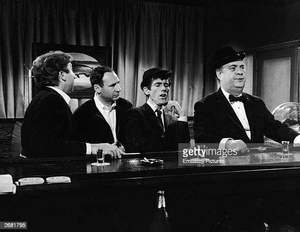 American writer and director Mel Brooks stands with actors Gene Wilder William Hickey and Zero Mostel on the set of the film 'The Producers' 1968