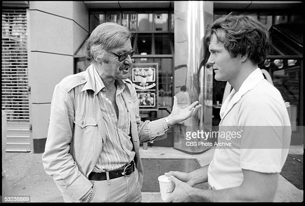 American writer and Marvel Comics founder Stan Lee gestures as he talks to actor Nicholas Hammond during the production of the television series 'The...