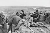 American writer Ernest Hemingway in a trench with fellow war correspondents during the Spanish Civil War circa 1937