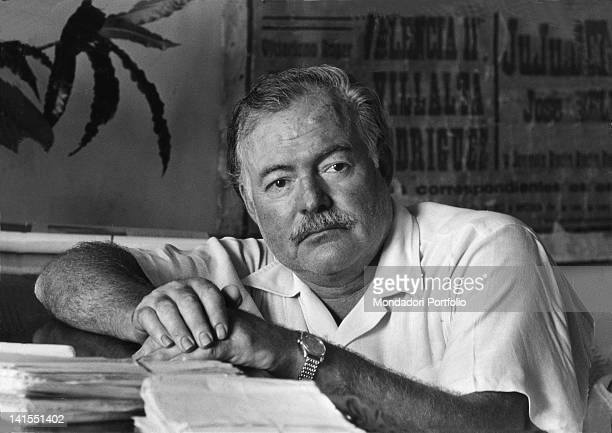 American writer Ernest Hemingway leaning on the desk of his office USA 1952