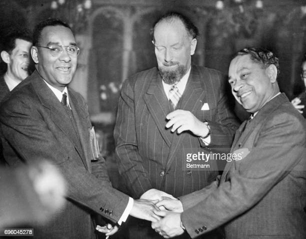 American Writer Richard Wright shaking hands with Gaston Monnerville President of the Republic of France and George Slocombe President of the press...