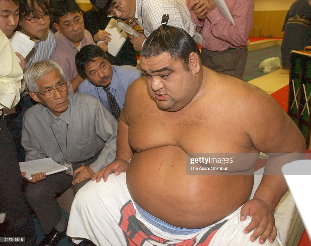 American yokozuna Musashimaru speaks to media reporters at a dressing room as he announces his retirement during day seven of the Grand Sumo Kyushu...