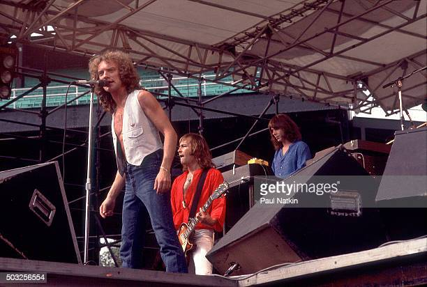 Americanbased rock band Foreigner performs onstage at Comiskey Park Chicago Illinois August 5 1978 Pictured are from left vocalist Lou Gramm Mick...