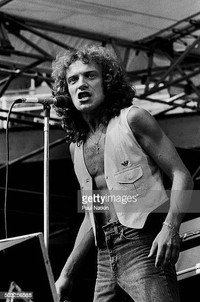 Americanbased rock band Foreigner performs onstage at Comiskey Park Chicago Illinois August 5 1978 Pictured is vocalist Lou Gramm