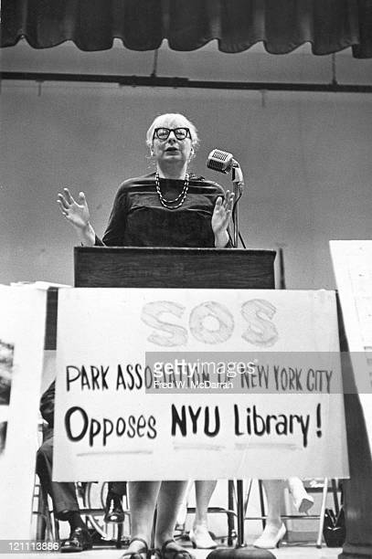 Americanborn Canadian social and urban activist author Jane Jacobs speaks from behind a lecturn at an event organized in opposition to the proposed...