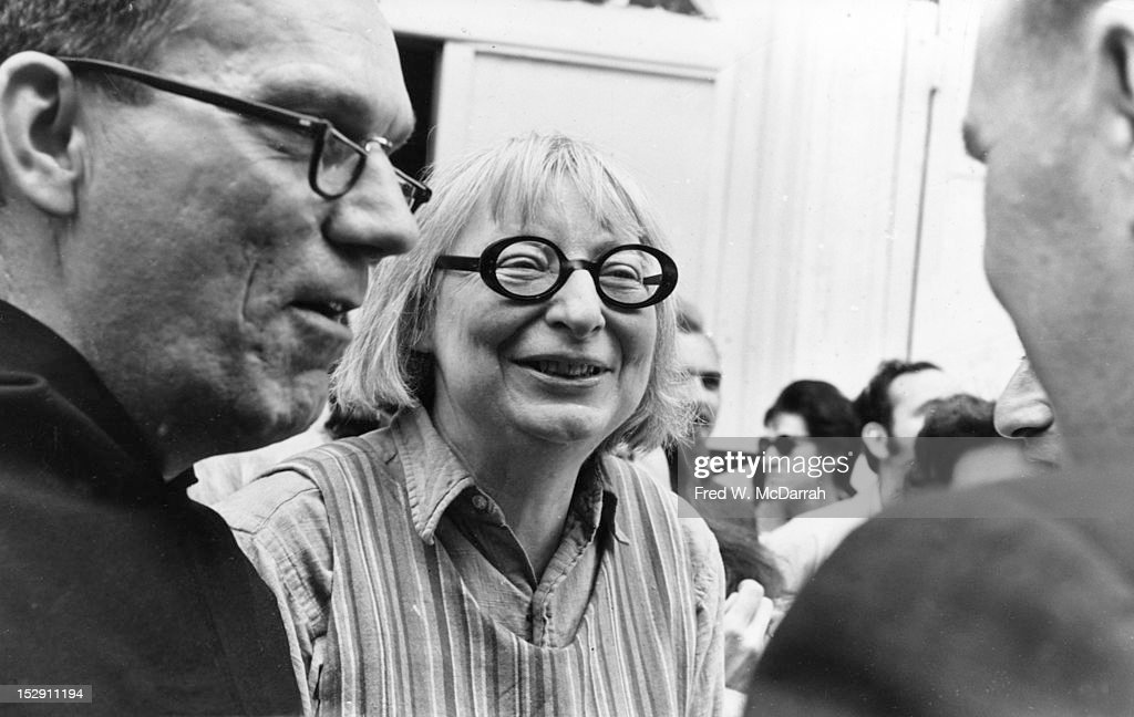 American-born Canadian social and urban activist & author <a gi-track='captionPersonalityLinkClicked' href=/galleries/search?phrase=Jane+Jacobs&family=editorial&specificpeople=1014340 ng-click='$event.stopPropagation()'>Jane Jacobs</a> (1916 - 2006) (center) speaks with unidentified others at an unspecified event, New York, New York, May 8, 1968.