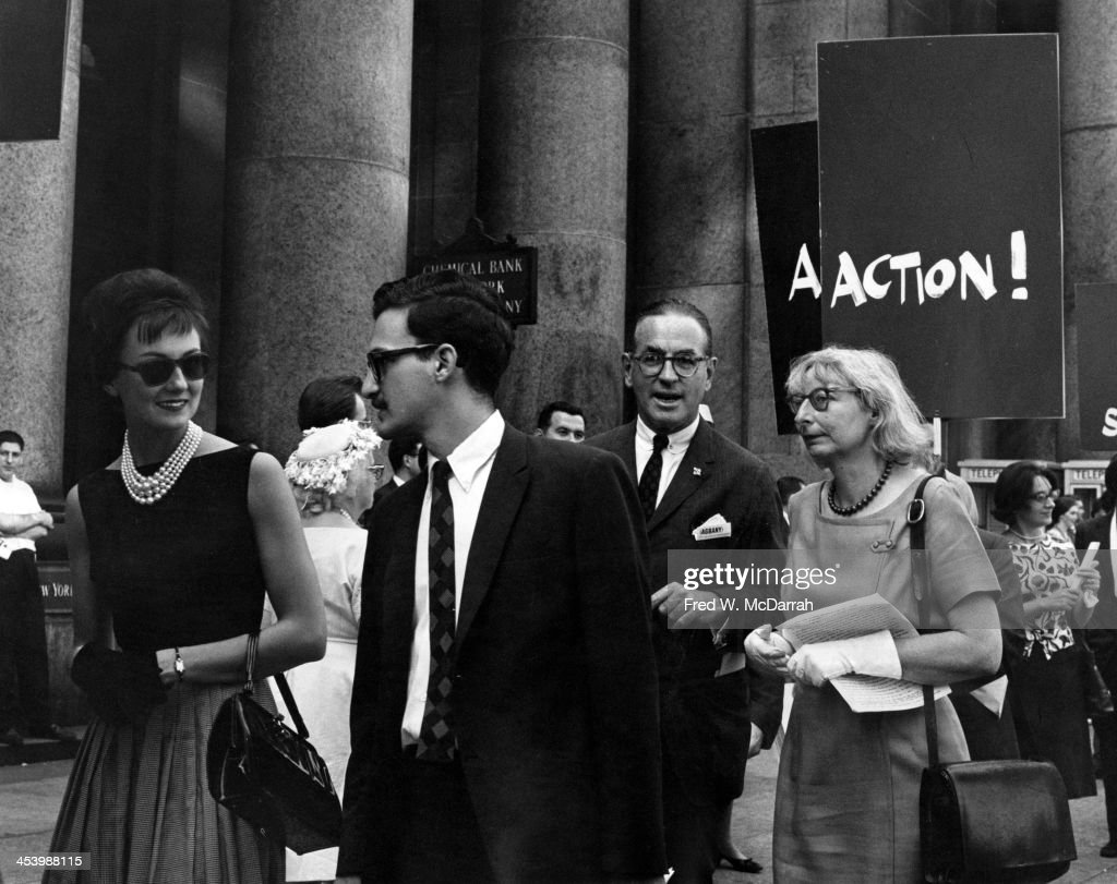 American-born Canadian social and urban activist & author <a gi-track='captionPersonalityLinkClicked' href=/galleries/search?phrase=Jane+Jacobs&family=editorial&specificpeople=1014340 ng-click='$event.stopPropagation()'>Jane Jacobs</a> (1916 - 2006) (fore, right) demonstrates, along with unidentified others, against the demolition of the original Pennsylvania Station, New York, New York, May 5, 1963. A placard in the background reads 'Action!' The structure was ultimately demolished, but the event is considered pivital in the passage of New York's first architectural preservation act.