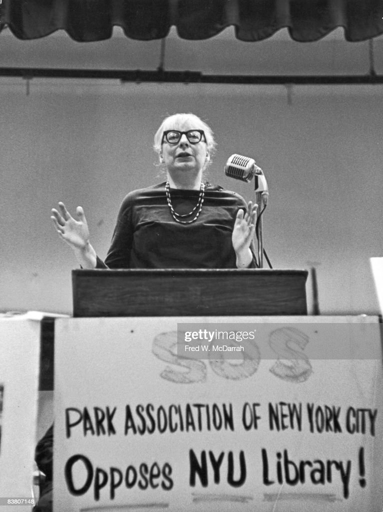 American-born Canadian social and urban activist & author <a gi-track='captionPersonalityLinkClicked' href=/galleries/search?phrase=Jane+Jacobs&family=editorial&specificpeople=1014340 ng-click='$event.stopPropagation()'>Jane Jacobs</a> (1916 - 2006) speaks from behind a lecturn at an event organized in opposition to the proposed construction of New York University's Elmer Holmes Bobst Library, New York, New York, June 20, 1966. The hand-written sign on lecturn reads 'SOS; Park Association of New York City Opposes NYU Library!'