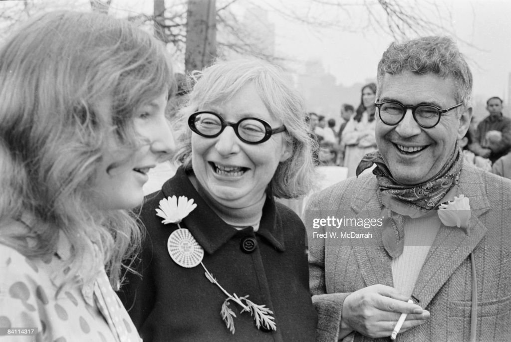 American-born Canadian social and urban activist & author <a gi-track='captionPersonalityLinkClicked' href=/galleries/search?phrase=Jane+Jacobs&family=editorial&specificpeople=1014340 ng-click='$event.stopPropagation()'>Jane Jacobs</a> (1916 - 2006) (center) smiles with her husband, architect Robert Hyde Jacobs (? - 1998), and their daughter, Burgin Jacobs, during an anti-Vietnam War demonstration in Central Park, New York, New York, April 15, 1967