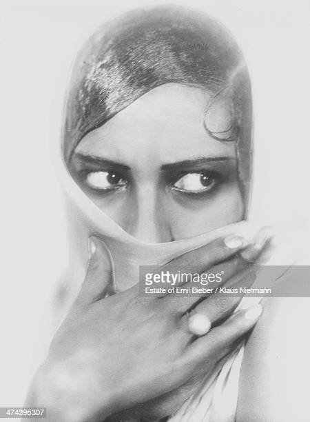 Americanborn French dancer singer and actress Josephine Baker covering her face with a veil Hamburg 1925