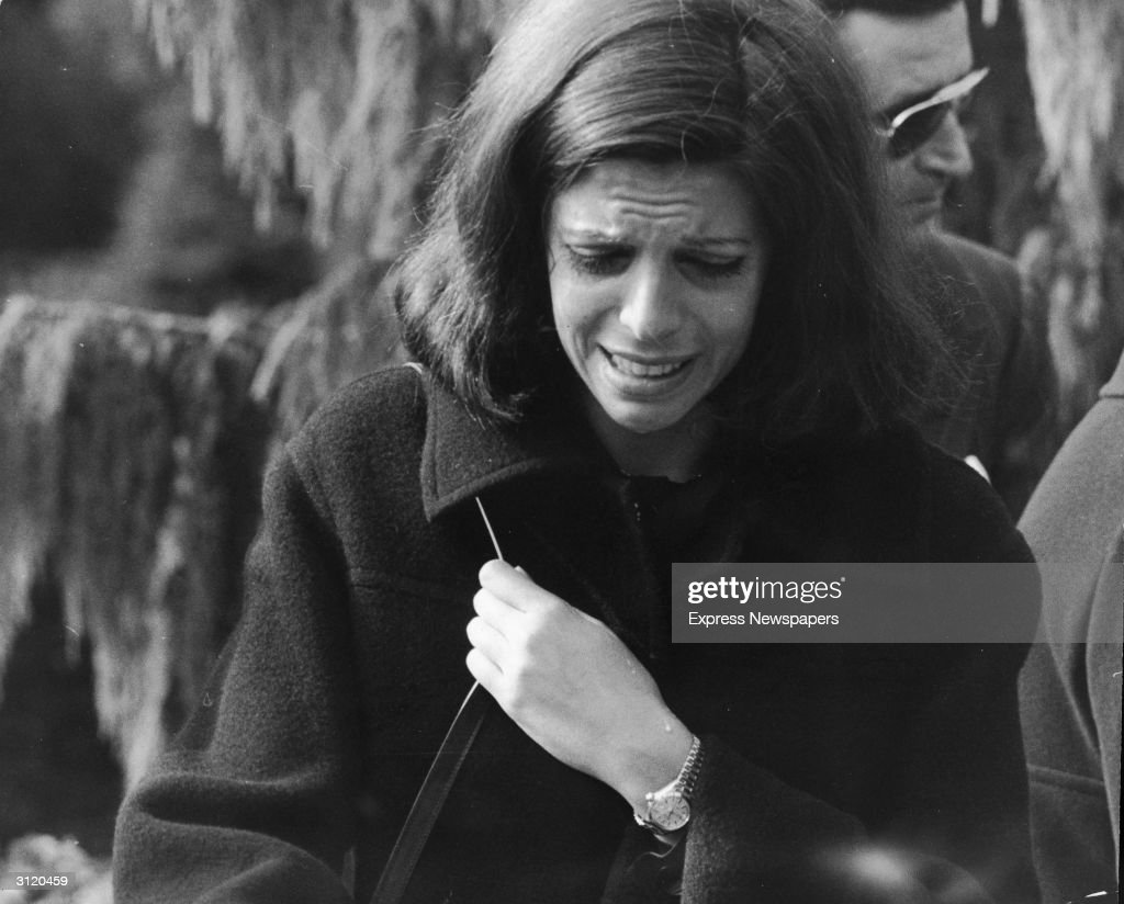 American-born shipping heiress Christina Onassis (1950 - 1988) grieves at her mother's funeral, October 17, 1973.
