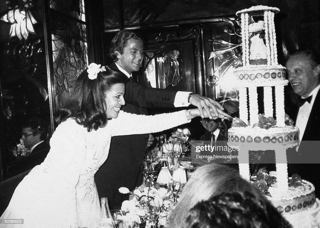 American-born shipping heiress Christina Onassis (1950 - 1988), the daughter of Greek shipping tycoon Aristotle Onassis, and her husband, French pharmeceutical heir Thierry Roussel, cut their wedding cake at their wedding reception, Paris, France, March 1984.