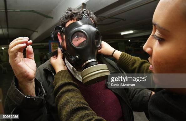 AmericanIsraeli Michael Satious who moved to Israel from Los Angeles 4 years ago is directed by an Israeli woman soldier on how to use his gas mask...
