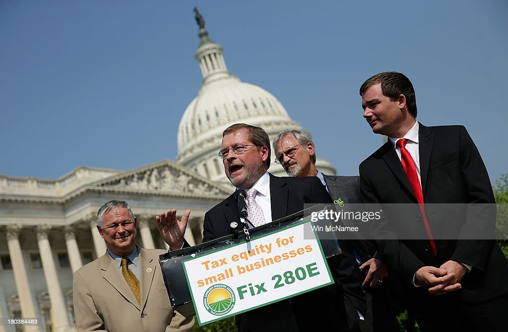 Americans for Tax Reform President <a gi-track='captionPersonalityLinkClicked' href=/galleries/search?phrase=Grover+Norquist&family=editorial&specificpeople=779501 ng-click='$event.stopPropagation()'>Grover Norquist</a> (2nd L), with (L-R) Rep. <a gi-track='captionPersonalityLinkClicked' href=/galleries/search?phrase=Dana+Rohrabacher&family=editorial&specificpeople=2337249 ng-click='$event.stopPropagation()'>Dana Rohrabacher</a> (R-CA), Rep. Earl Blumenauer (D-OR), and Aaron Smith, Executive Director of the National Cannabis Industry Association, speaks during a press conference discussing the taxation of marijuana businesses outside the U.S. Capitol September 12, 2013 in Washington, DC. The National Cannabis Industry Association is seeking tax reform to change the current policy that requires medical marijuana providers to pay taxes based on gross receipts rather than income.