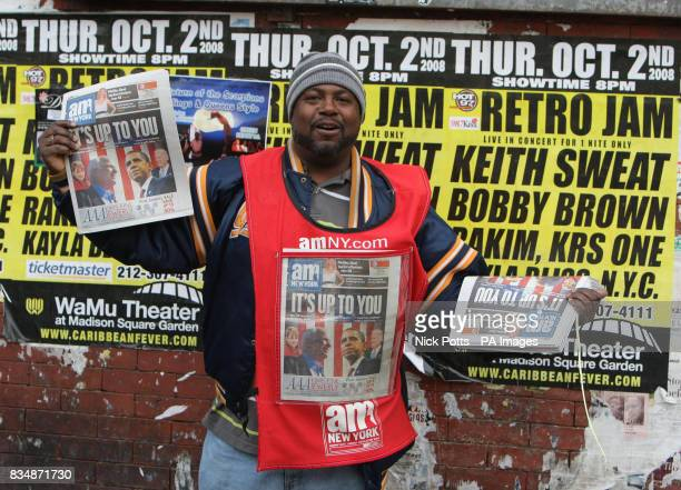 American's newspapers saleman outside junction of 125th street subway and Martin Luther King Jnr Boulvard in Harlem New York USA