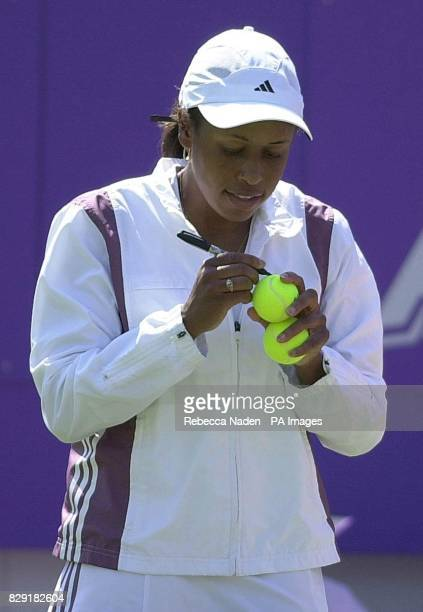 America's Chanda Rubin hits autographed tennis balls to the crowd after defeating Italian Silvia Farina Elia in the Britannic Asset Management...