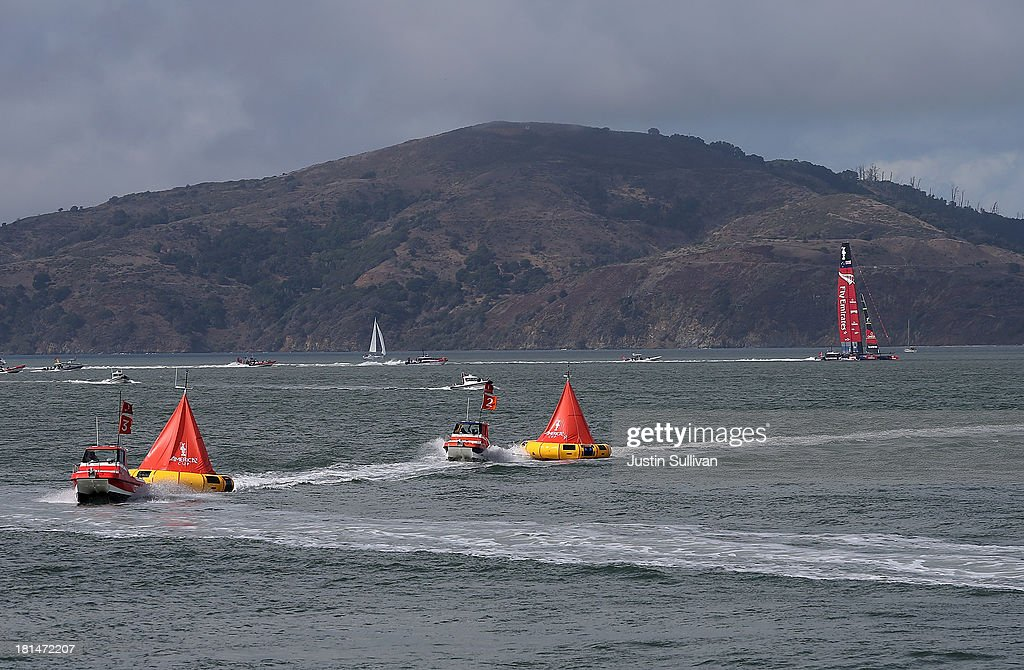 America's Cup boats pull in markers as Team Emirates New Zealand skippered by Dean Barker sails home after race 14 of the America's Cup finals was postponed on September 21, 2013 in San Francisco, California. Race 14 was postponed due to weather.