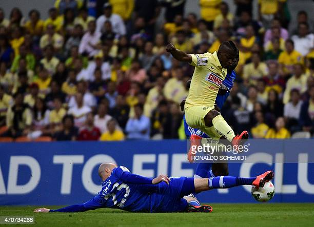 America's Darwin Quintero from Mexico vies for the ball with Laurent Ciman and Hassoun Camara of Montreal Impact of Canada during their CONCACAF...