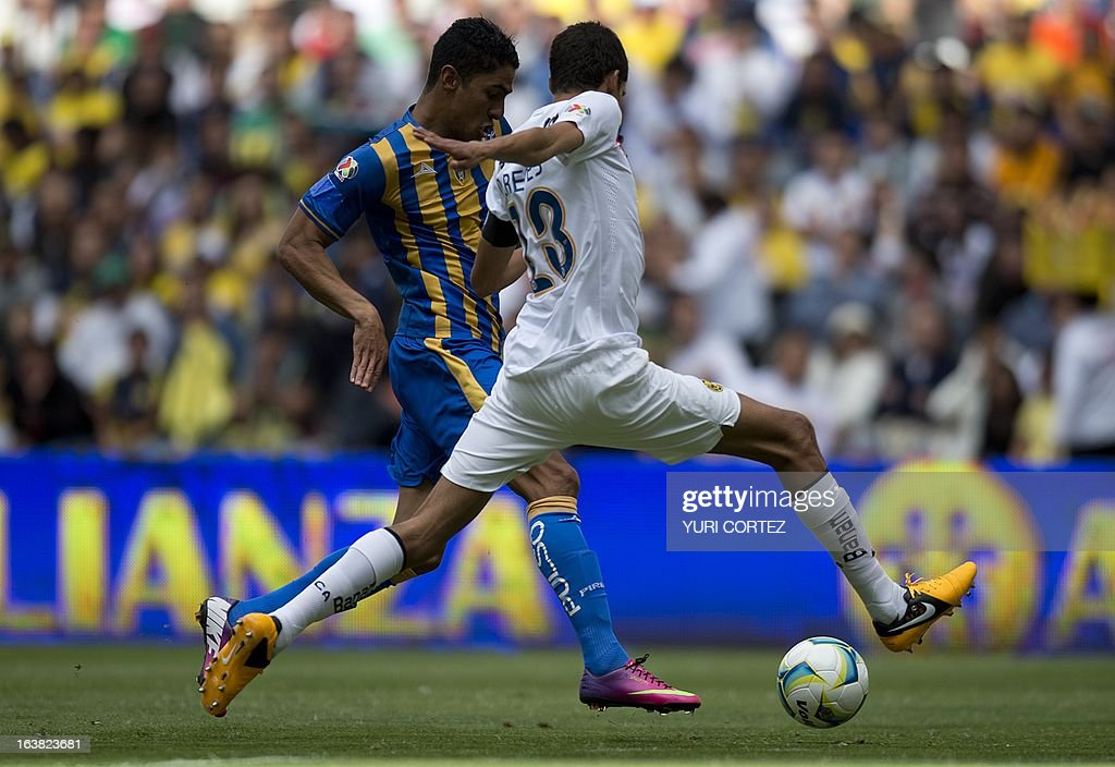 America's defender Diego Reyes (R) disputes the ball with San Luis's forward Santiago Trellez (L) during their Clausura 2013 Mexican league football match at the Azteca stadium in Mexico City, on March 16, 2013. AFP PHOTO/YURI CORTEZ