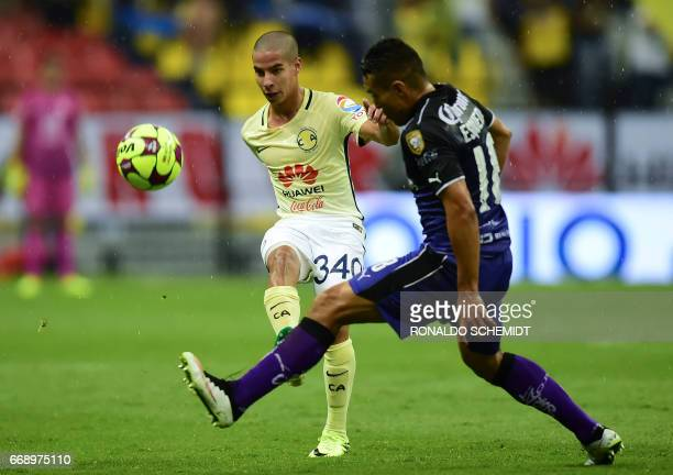 America´s Diego Lainez vies for the ball with Queretaro´s Luis Esqueda during their Mexican Clausura 2017 tournament football match at the Azteca...