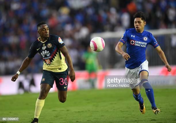 America's Ecuadorean midfielder Alex Ibarra and Cruz Azul's Chilean Martin Rodriguez run or the ball during their Mexican Apertura football...