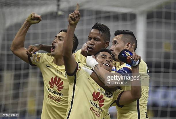 America's footballers celebrate after scoring the second goal goal against Tigres during their CONCACAF Champions League final football match at the...